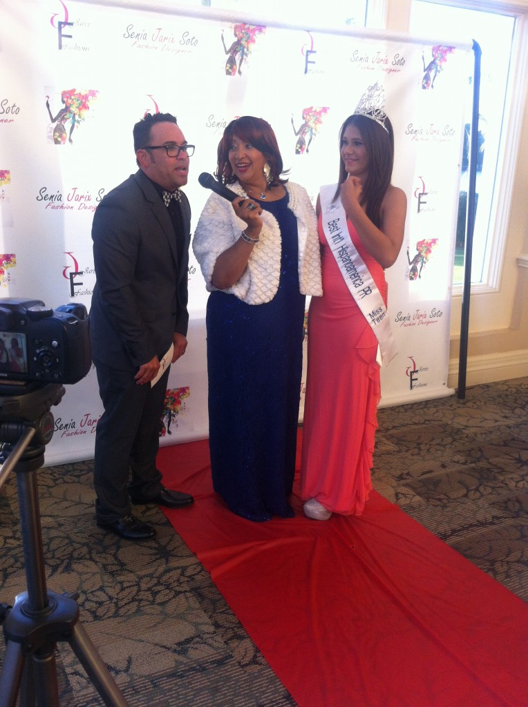 """The Jorge Show"" host Jorge Alvarado (left) interprets for Jarix Fashion Show hostess Angie Bee (center) and Miss Teen World of Puerto Rico, Genesis M. Caraballo during her red carpet interview. Source: Mellissa Thomas."