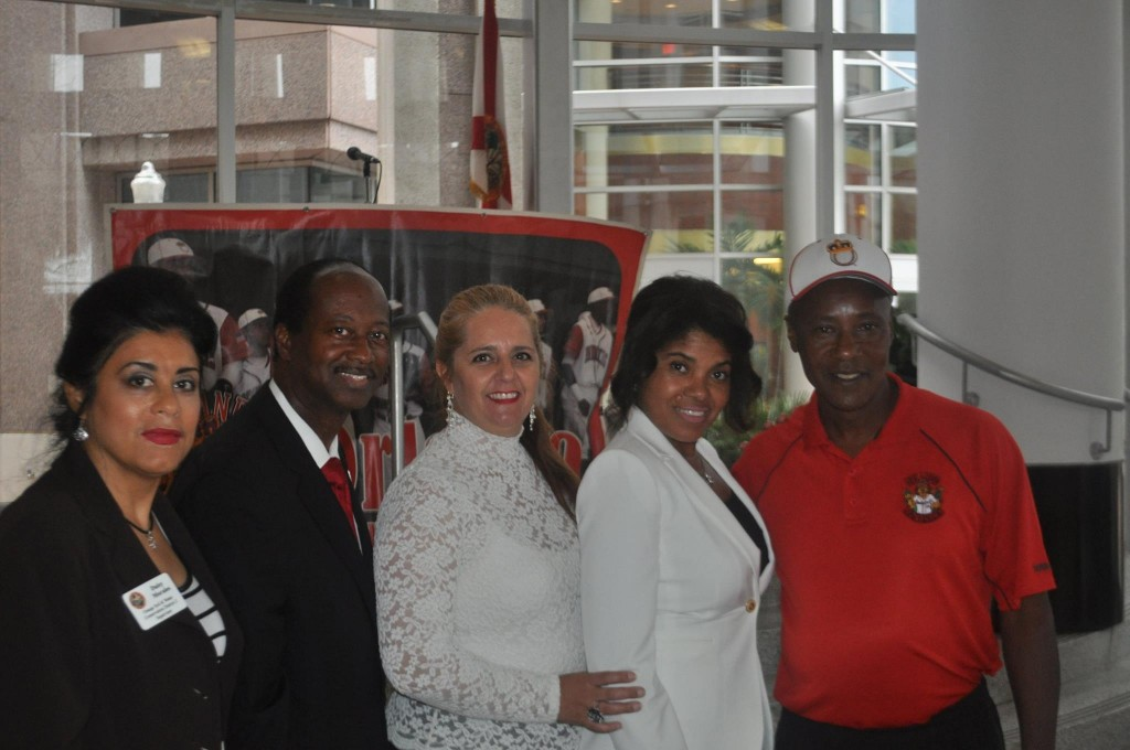 District 2 Soil & Water Conservation Supervisor Daisy Morales (left), District 6 Commissioner Samuel B. Ings (2nd left), and Rickie Weeks (far right) at the Orlando Monarchs Baseball Kickoff Reception, made possible with the help of his OMB team leadership and community partners like Donna Morton-Morgan (2nd right). Photo: J. Willie David, III/Florida National News.