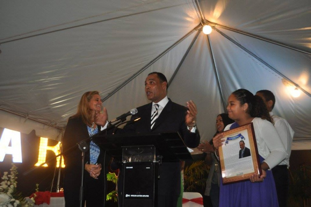 Ambassador Rudy Moise makes his acceptance speech upon his induction into the North Miami Hall of Fame with the support of his family. Source: J. Willie David III/Florida National News.