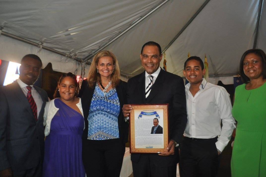 Ambassador Rudy Moise accepts the North Miami Hall of Fame plaque with the support of his family and North Miami Mayor Smith Joseph, at left. Source: J. Willie David III/Florida National News.