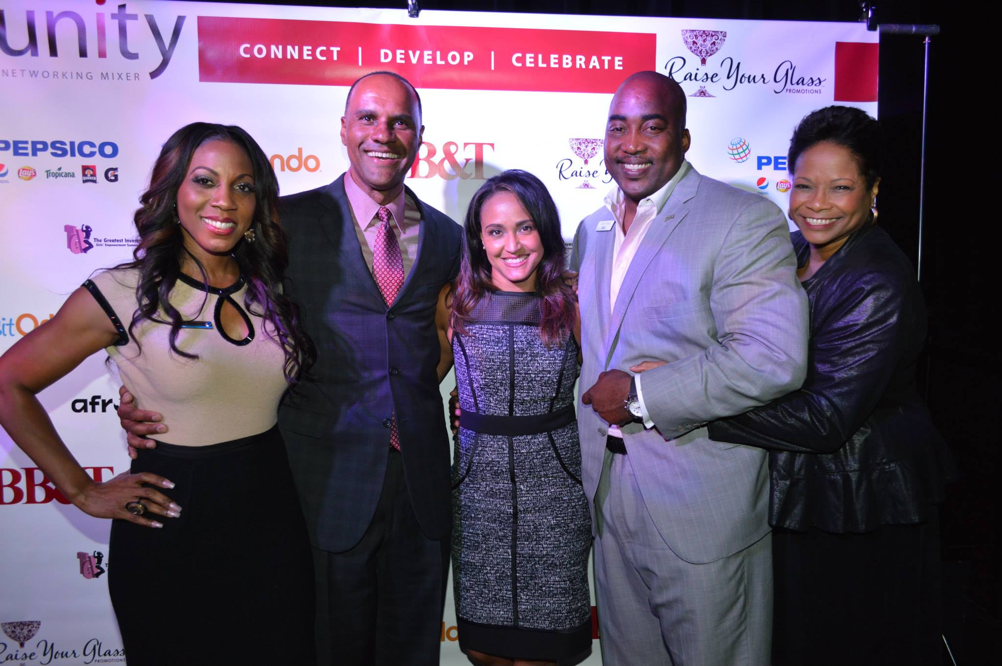 Raise Your Glass Promotions CEO Gigi Moorman (center) at a recent UNITY Executive Suite panel discussion event with (l-r) Lynette Jackson-Lott, Pepsi North America SVP/General Manager Derek Lewis, BB&T's Tony Coley, and Annette Wilson. Photo courtesy of Raise Your Glass Promotions.
