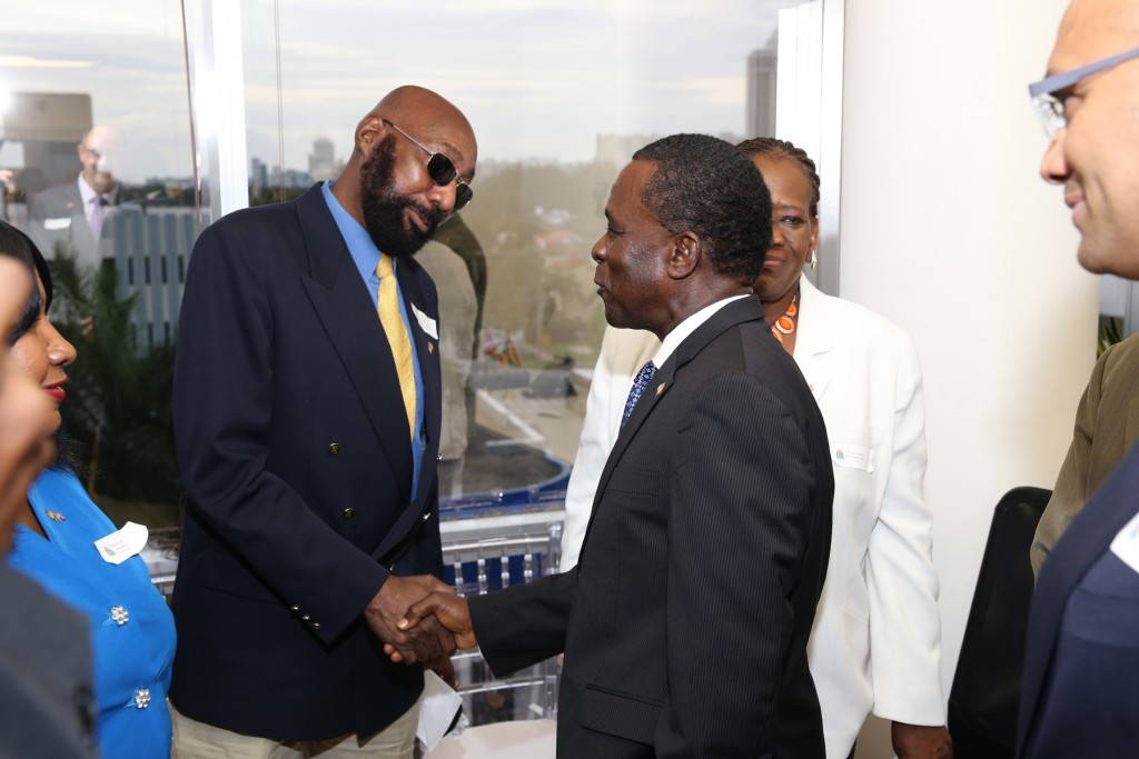John Munro, president of Grenadian-American Educational & Cultural Organization of Central Florida (left) and Grenada's Prime Minister Keith Mitchell at the opening ceremony of the Consulate General to Grenada in Miami Beach, Florida. Photo: Florida National News.