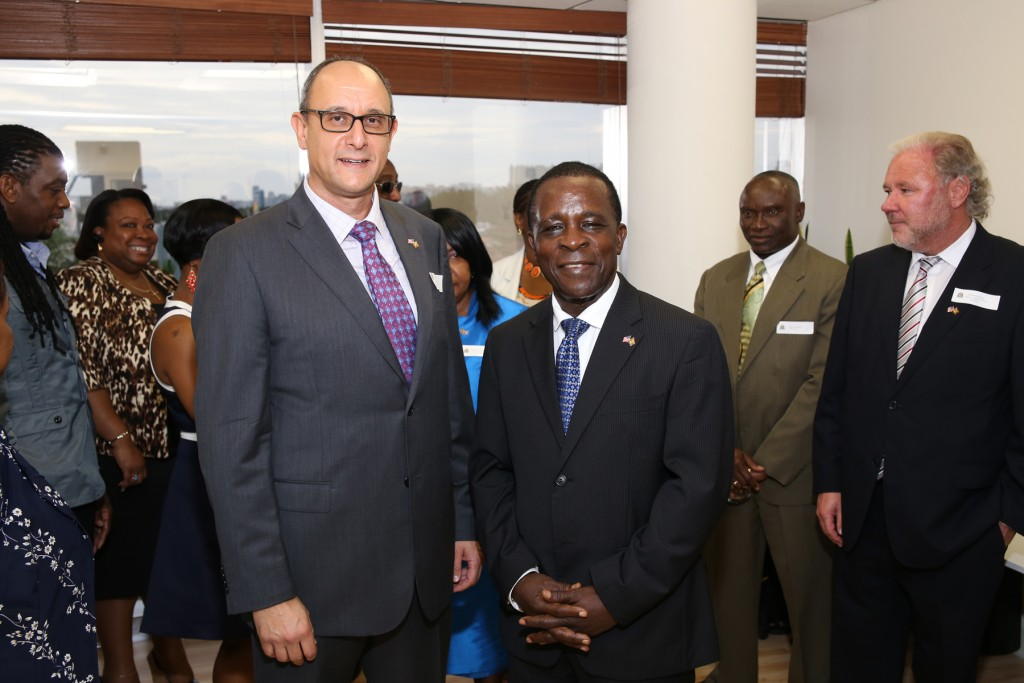 Consul General Warren Newfield (left) and Grenada's Prime Minister Keith Mitchell (center) at the opening ceremony of the Consulate General to Grenada in Miami Beach, Florida. Photo: Florida National News.