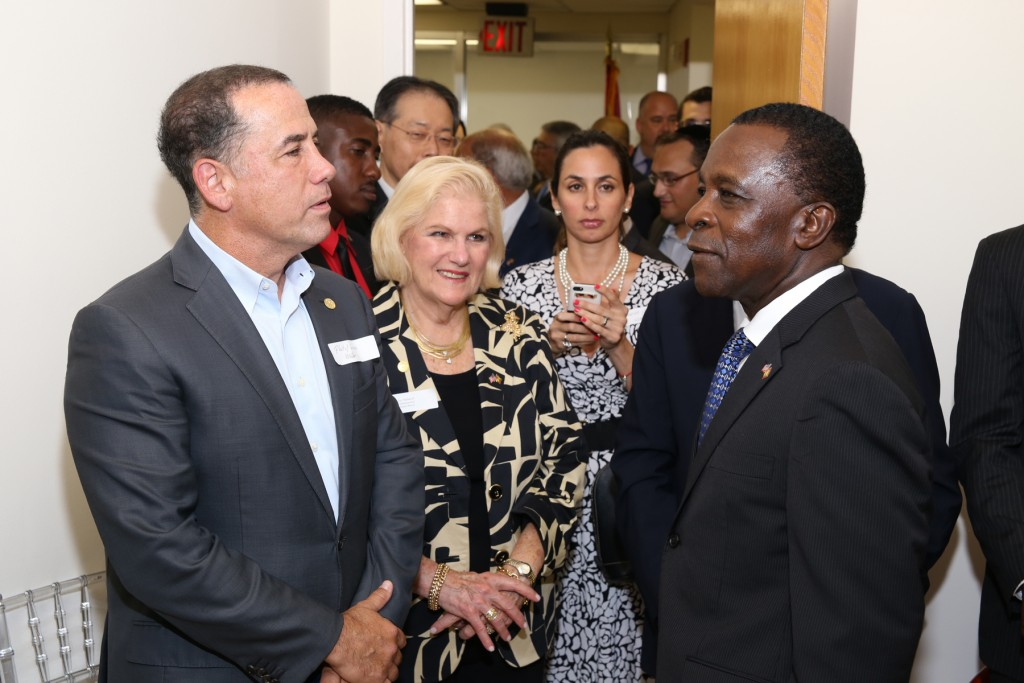 Mayor of Miami Beach Philip Levine (left), City Commissioner Joy Malakoff (2nd left) and Grenada's Prime Minister Keith Mitchell at the opening ceremony of the Consulate General to Grenada in Miami Beach, Florida. Photo: Florida National News.