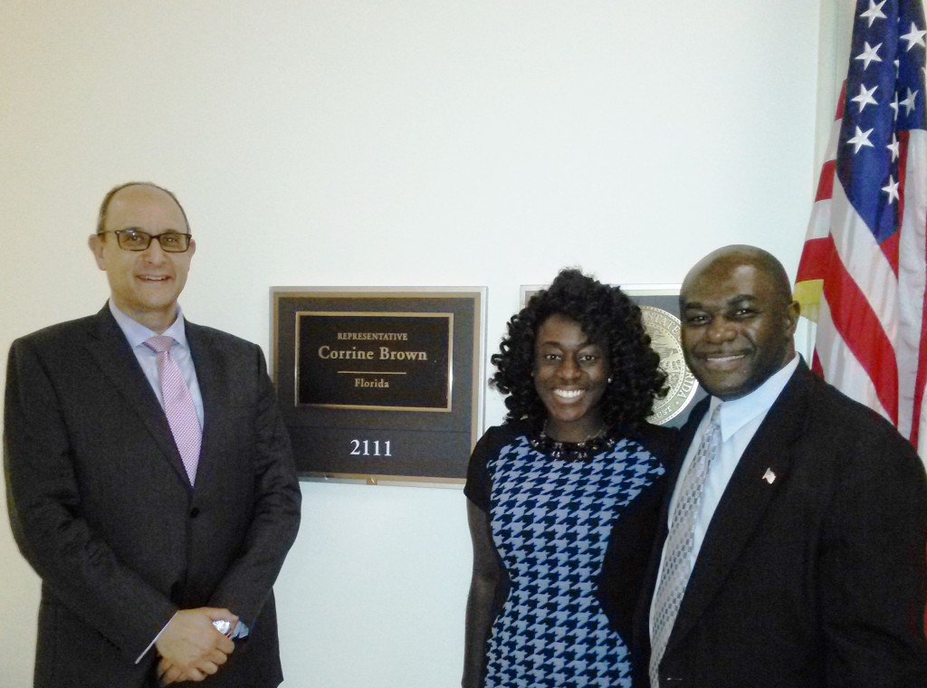 Consul General Warren Newfield (left) and Willie David, Diplomatic Consultant on Foreign Relations, talk with Stephanie Anim-Yankah, Congressional Aide to Congresswoman Corrine Brown about investment opportunities in Grenada in Washington, D.C. on June 11, 2015. Photo: J Willie David III/Florida National News.