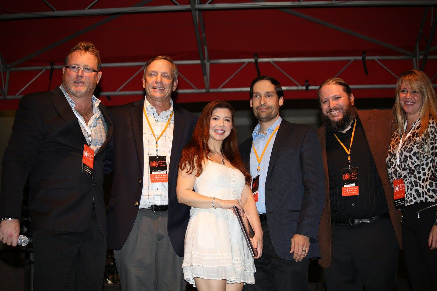 """Orlando Film Festival Executive Director Dan Springen (left) and Senior Vice President Holley Morgan (right) present producer Karl Schaulin, lead actress Michelle Martin, director Charles Huddleston, and cinematographer Kraig Schaulin receive the Best Picture award for """"Blue"""" at the OFFX Award Ceremony Saturday. Photo: J. Willie David III/Florida National News."""