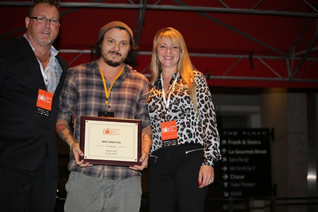 """James Bird, who has won several Orlando Film Festival awards in the past, receives the Best Director award for """"Honey Glue"""" at the OFFX Award Ceremony Saturday. Photo: J. Willie David III/Florida National News."""