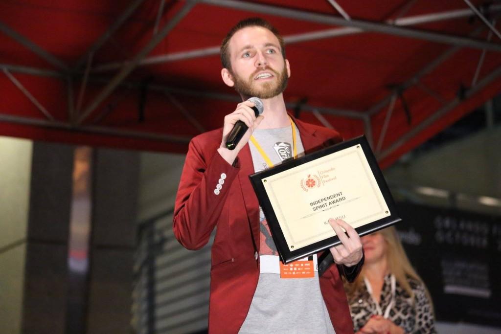 "James Noir accepts the Orlando Film Festival Independent Spirit Award for ""Kaijutsu"" at the OFFX Awards Ceremony Saturday. Photo: J. Willie David III/Florida National News."