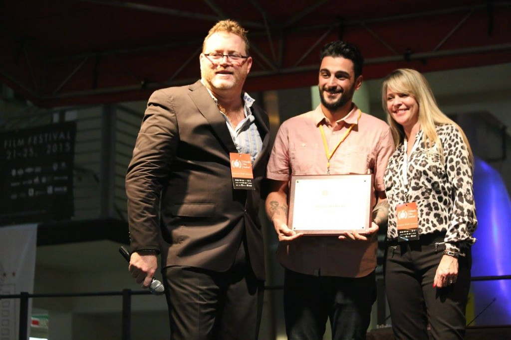"""Writer and director Nick DeRuve receives the Best Screenplay award for """"The Runaway"""" at the OFFX Award Ceremony Saturday. Photo: J. Willie David III/Florida National News."""