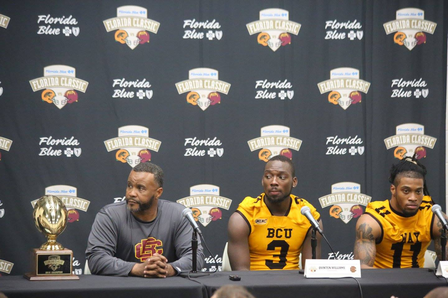 (l-r) Bethune-Cookman University Wildcats head coach Terry Simms, QB Quentin Williams, and LB Robert Way speak at the post-game press conference. Photo: J. Willie David III/Florida National News.
