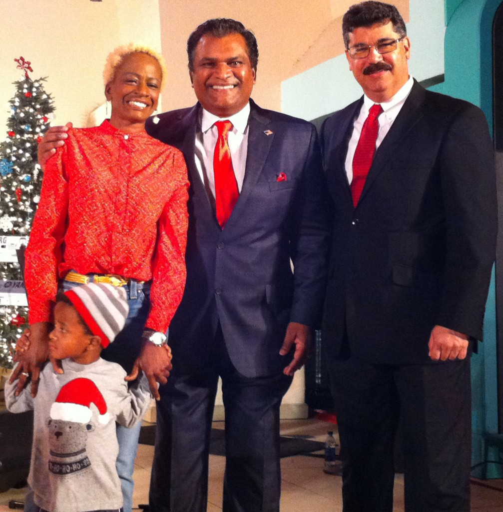(l-r) Commissioner Regina Hill with her grandson, Orange County Property Appraiser Rick Singh, and Commissioner Tony Ortiz. Photo: Mellissa Thomas/Florida National News.