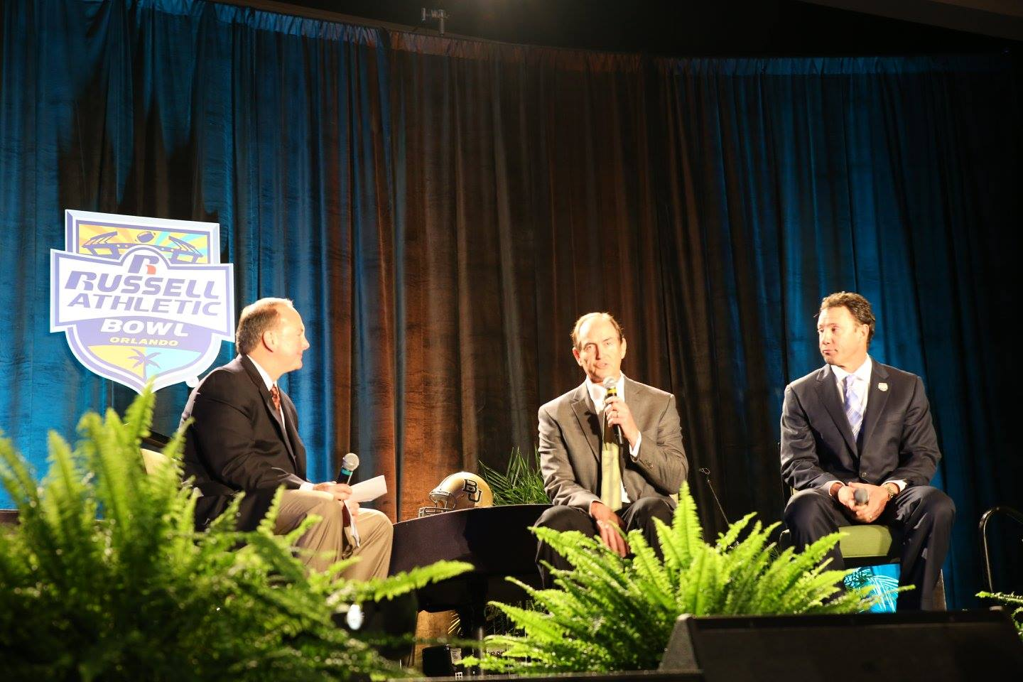 Dr. Jerry Punch interviews Baylor Head Coach Art Briles (center) and University of North Carolina Head Coach Larry Fedora (right) during the Russell Athletic Bowl Kickoff Luncheon at Hilton Orlando Monday. Photo: Mellissa Thomas/Florida National News.