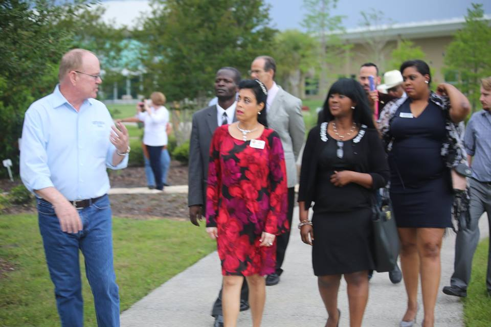 File - The Honorable Daisy Morales (foreground, in red), Supervisor with the Orange Soil and Water Conservation District held the 2nd annual Earth Day Forum and Awareness Tour at the Orange County Extension Center in Orlando, Friday, April 22, 2016. Photo by Mellissa Thomas/Florida National News