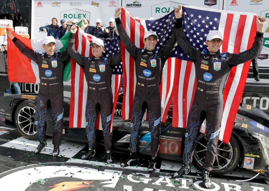 DAYTONA (FNN SPORTS) - Max Angelelli, Jeff Gordon, Ricky Taylor and Jordan Taylor celebrate Rolex 24 At Daytona victory Sunday. Photo: John Raoux/AP.