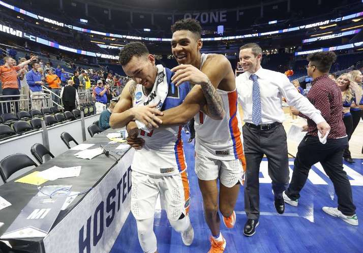 ORLANDO (FNN SPORTS) - UF Gators' Chris Chiozza (left) and Devin Robinson celebrate after their win against Virginia at Amway Center Saturday, March 18, 2017. Photo: Octavio Jones/Tampa Bay Times.