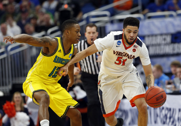 ORLANDO (FNN SPORTS) - Darius Thompson (right) and UVA fought hard against UNCW for the win at Amway Center Thursday, March 16, 2017. Photo: Kim Klement/USA TODAY SPORTS