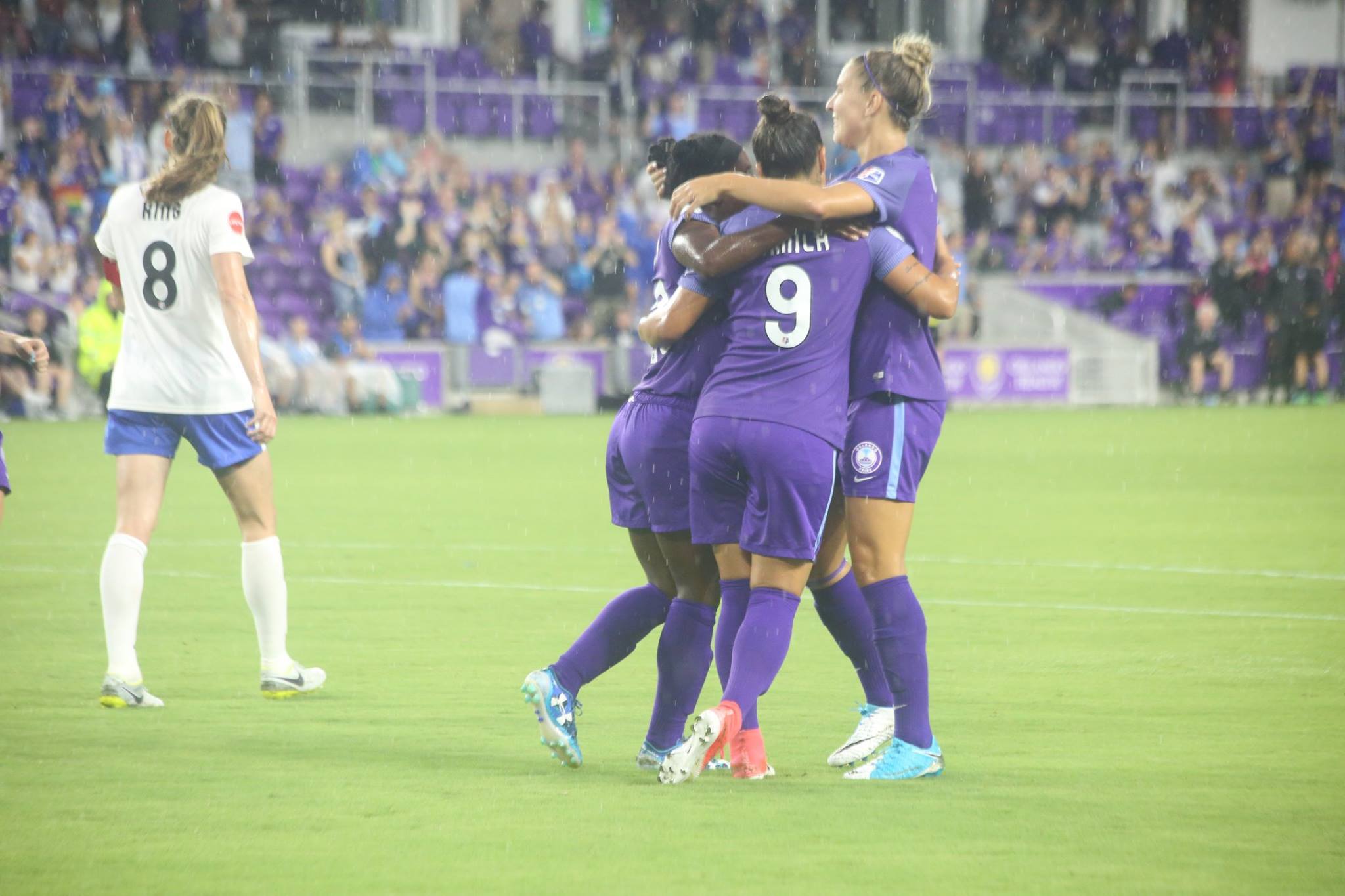 ORLANDO (FNN SPORTS) - (l-r) Jasmyne Spencer, Camilla, and Steph Catley celebrate Spencer's third season goal against Boston Breakers at Orlando City Stadium June 3, 2017. Photo: Willie David/Florida National News.