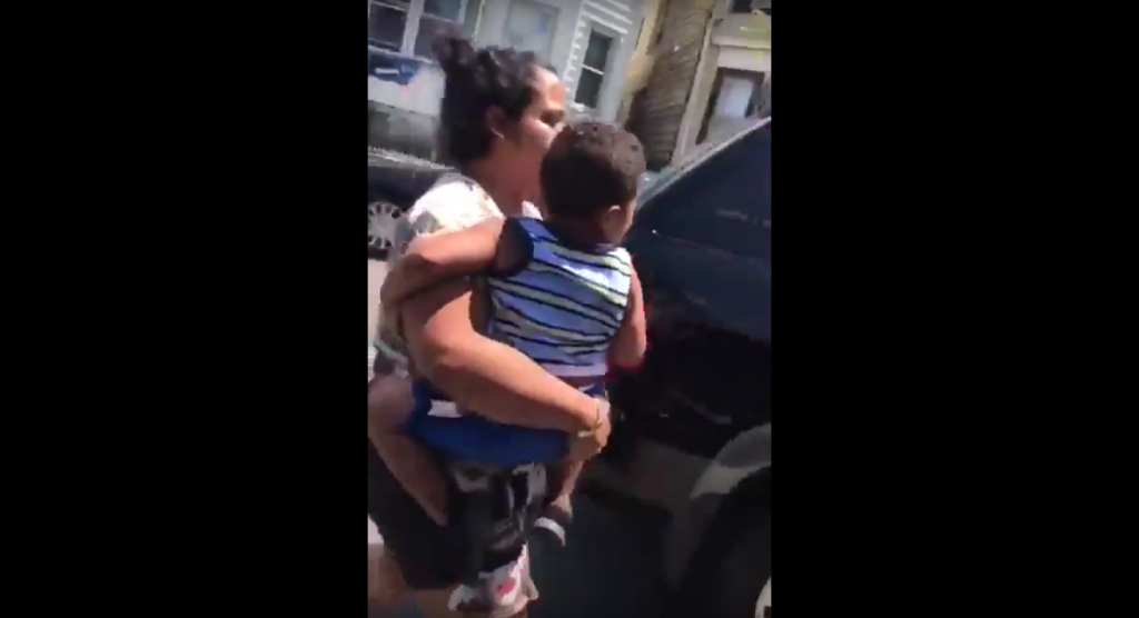 The Paterson, NJ woman takes her son from her ex's SUV after smashing out his windows and lights Sunday.