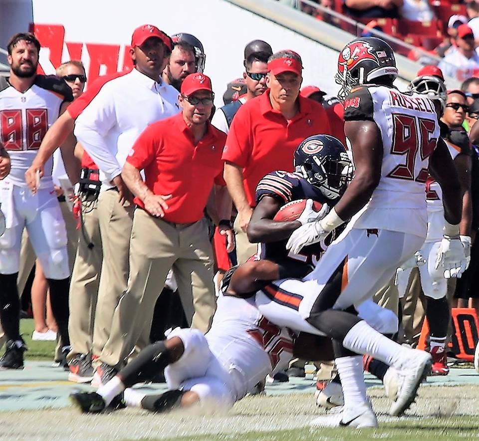 TAMPA (FNN SPORTS) - Tampa Bay Buccaneers' William Gholston (92) tackles Chicago Bears' Tarik Cohen (29) during the Bucs' decisive season home opener at Raymond James Stadium Sunday. Photo: Willie David/Florida National News.
