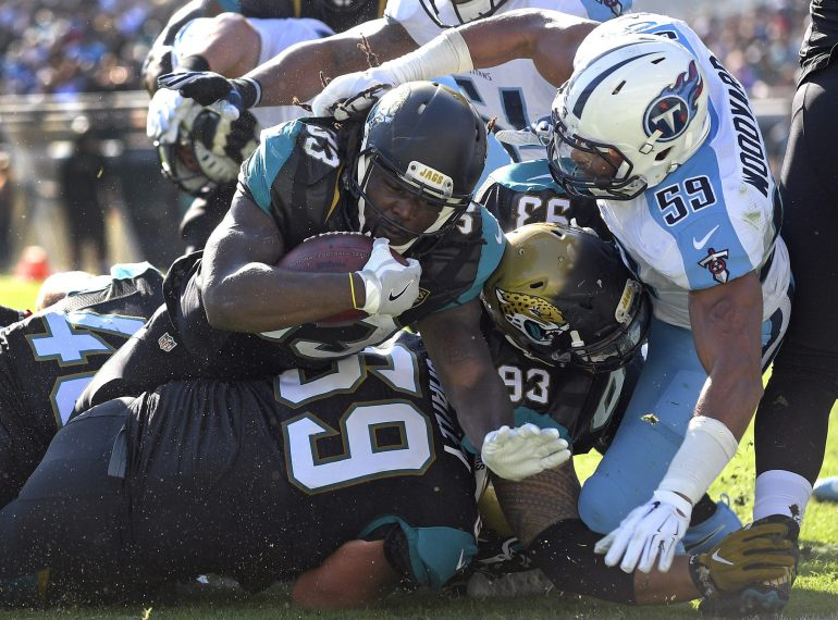JACKSONVILLE (FNN SPORTS) - After a slow start, the Tennessee Titans used their ground game to wear down the Jacksonville Jaguars at EverBank Field Sunday. Photo: Phelan M. Ebenhack/AP.