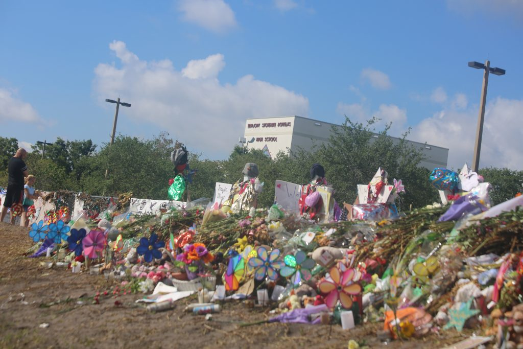 Tributes and memorials have increased in the month since the mass shooting at Marjory Stoneman Douglas High School. Photo: Willie David/Florida National News