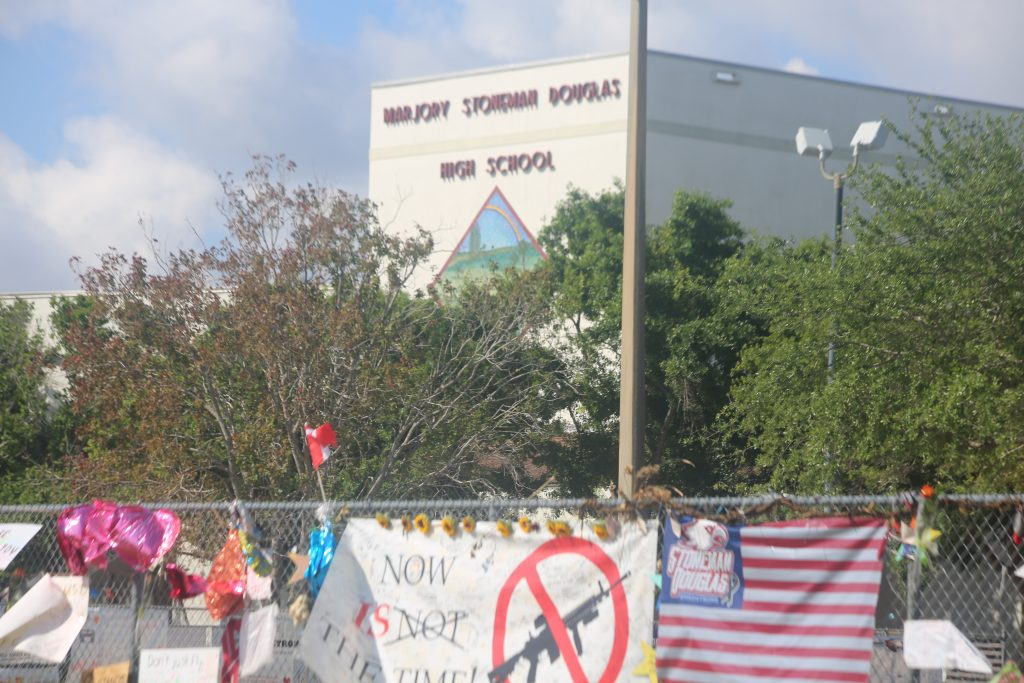 Signs of solidarity and gun control activism cover the Marjory Stoneman Douglas High School campus after the mass shooting on Valentine's Day. Photo: Willie David/Florida National News