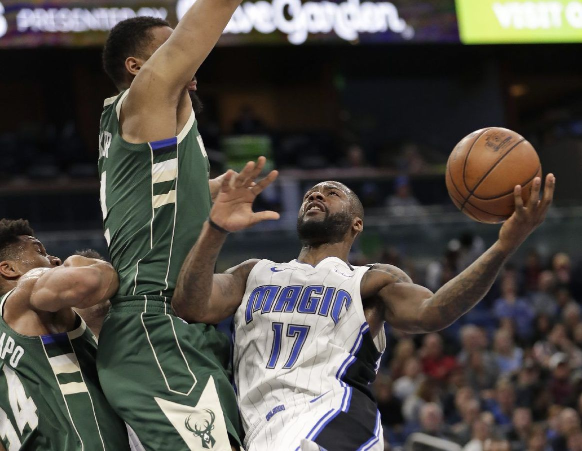 ORLANDO (FNN SPORTS): Jonathon Simmons and DJ Augustin powered their way to a much-needed victory against Milwaukee at Amway Center. Photo: AP.