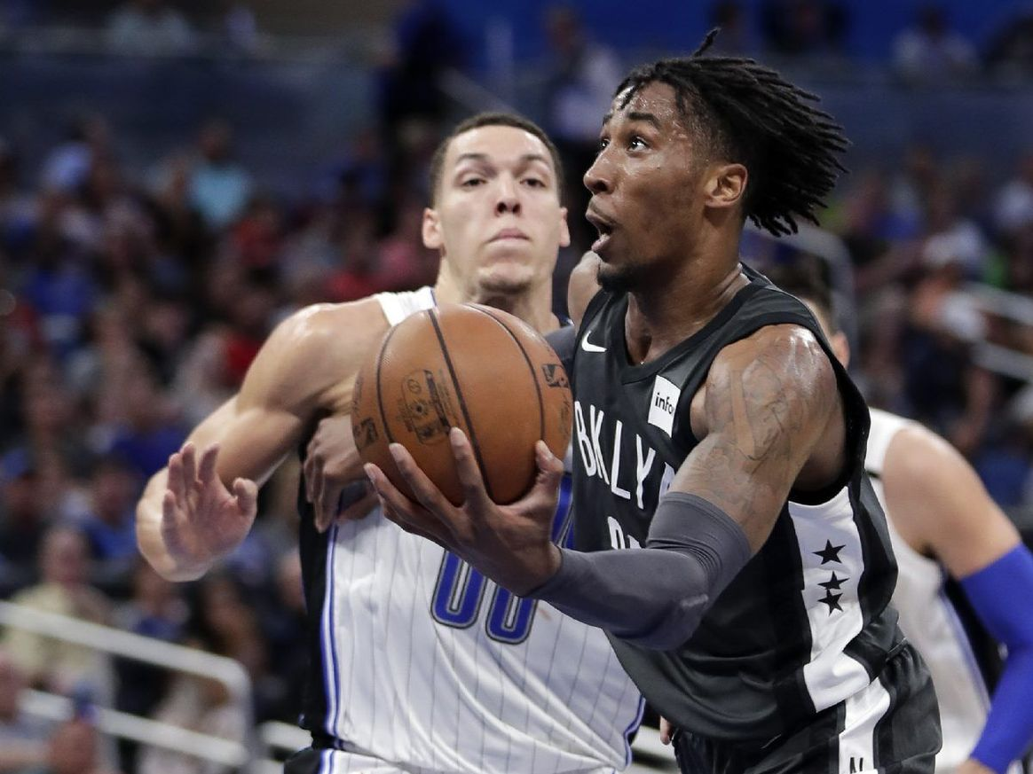 ORLANDO (FNN SPORTS): Aaron Gord0n (left) and the Magic couldn't quite fend off the Brooklyn Nets Wednesday. Photo: AP.
