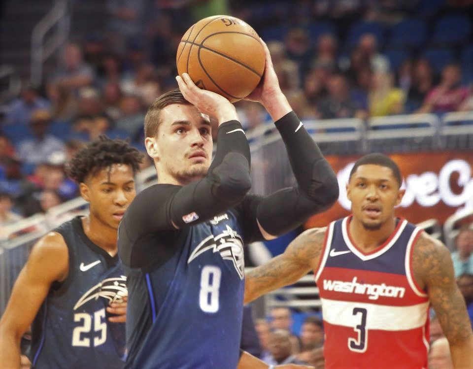 ORLANDO (FNN SPORTS): Mario Hezonja (center) and the Magic defensively rallied in the fourth quarter to secure a season closeout victory against the Washington Wizards. Photo: Willie David/Florida National News.
