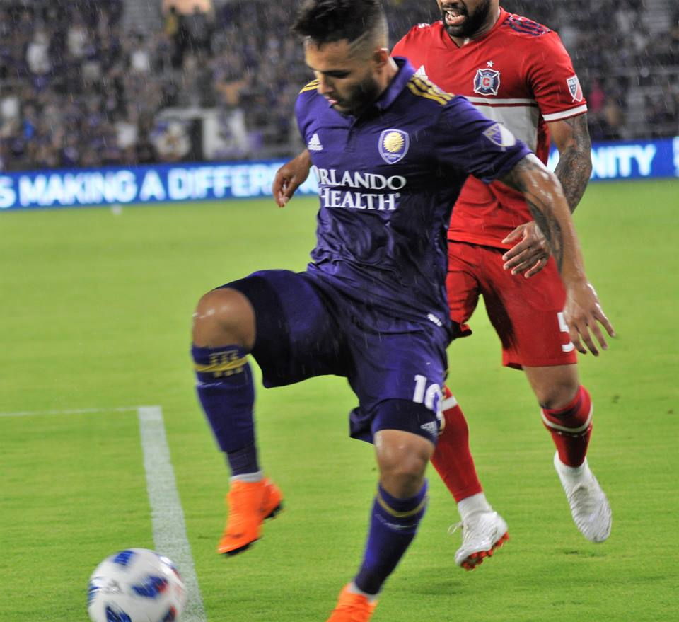 ORLANDO (FNN SPORTS) - Josue Colman (foreground) and Orlando City dominated for much of the game, but Chicago's late goal turned the tide. Photo: Willie David/Florida National News.