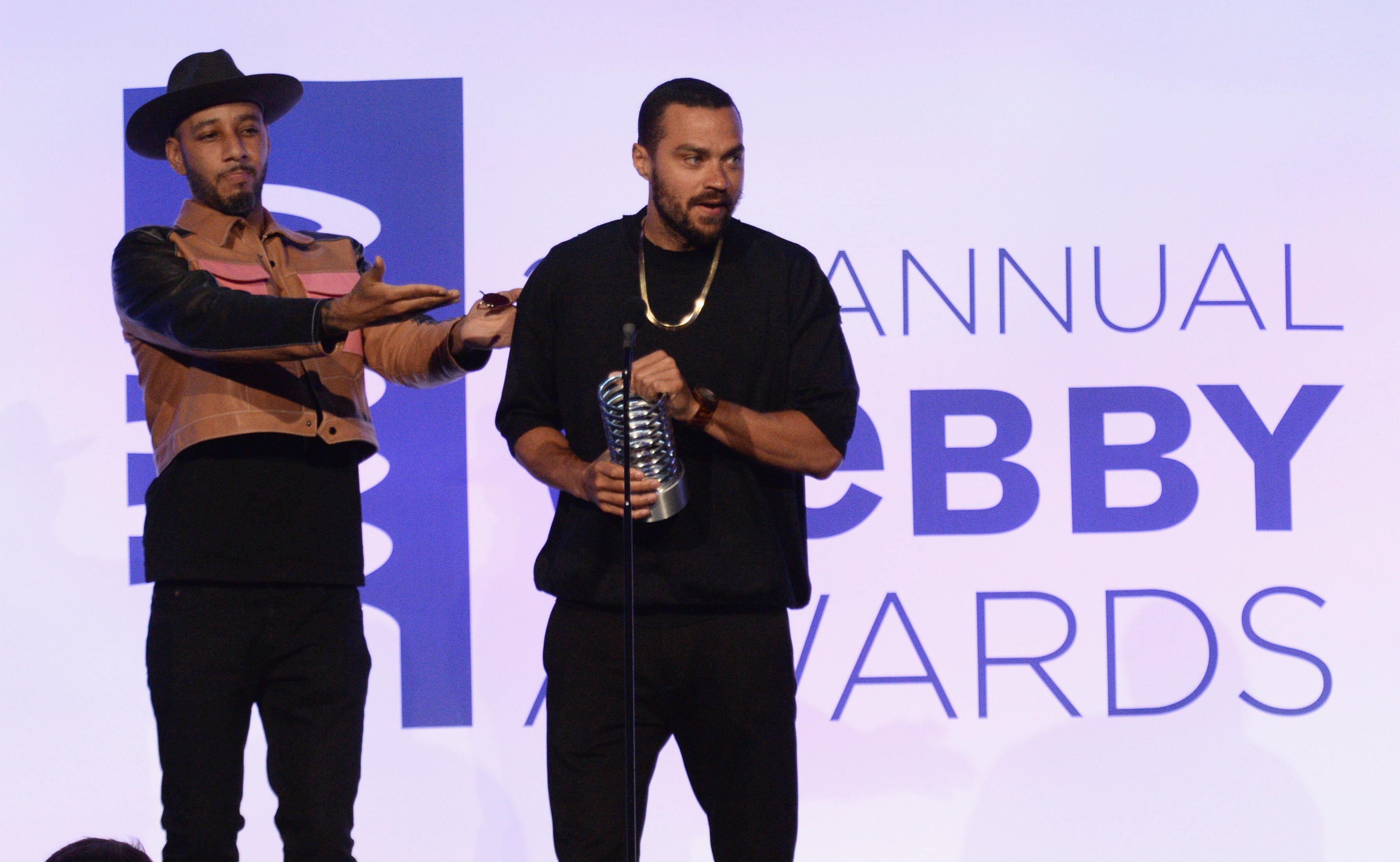 NEW YORK (FNN NEWS) - Recording Artist Swizz Beatz (left) presents an award to Jesse Williams at the 22nd Annual Webby Awards. Photo by Andrew Toth/Getty Images for The Webby Awards