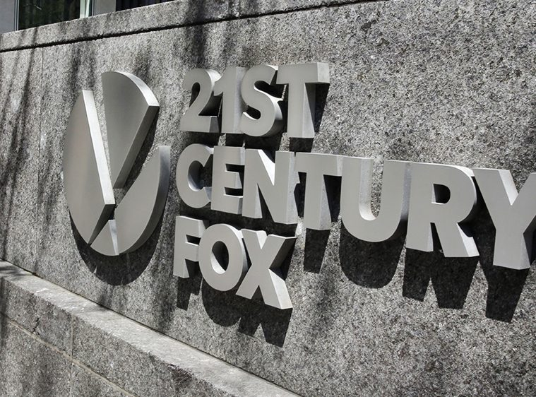 NEW YORK (AP) - AT&T's recent victory in acquiring Time Warner emboldened Comcast to outbid Disney for 21st Century Fox to the tune of $60 billion. Photo: AP/REX/Shutterstock