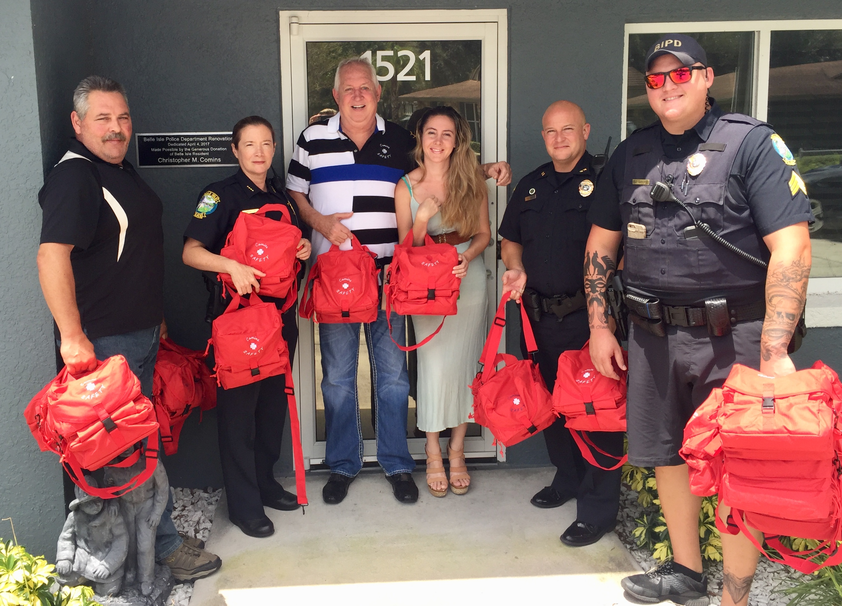 BELLE ISLE, Fla. Chris Comins (center, striped shirt) provided the Belle Isle police with trauma kits for school protection in the event of disaster or tragedy. Photo courtesy of Chris Comins.