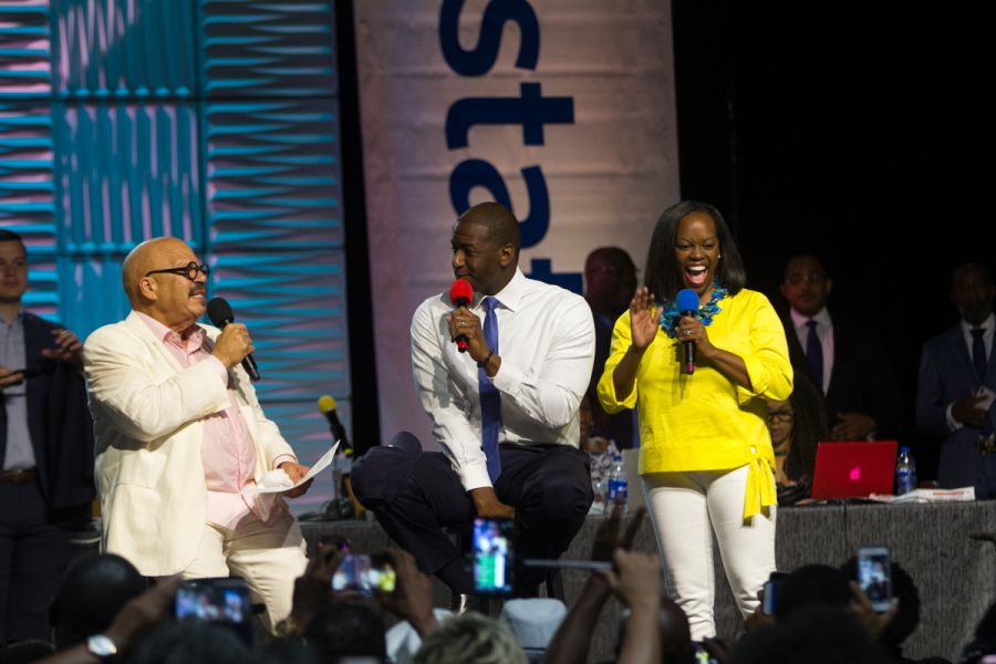 Tallahassee Mayor and Florida Democratic gubernatorial nominee Andrew Gillum and his wife R. Jai joined Tom Joyner for a live interview at the 2018 AllState Tom Joyner Family Reunion. Photo: BlackAmericaWeb.com.