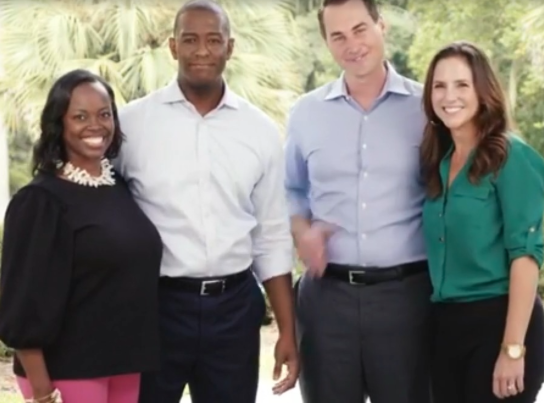 TALLAHASSEE (FNN NEWS) - Winter Park entrepreneur and former Democratic gubernatorial opponent Chris King (2nd right) and his wife Kristen joined Tallahassee Mayor Andrew Gillum and his wife R. Jai for Gillum's announcement of King as his running mate. Image: Andrew Gillum.