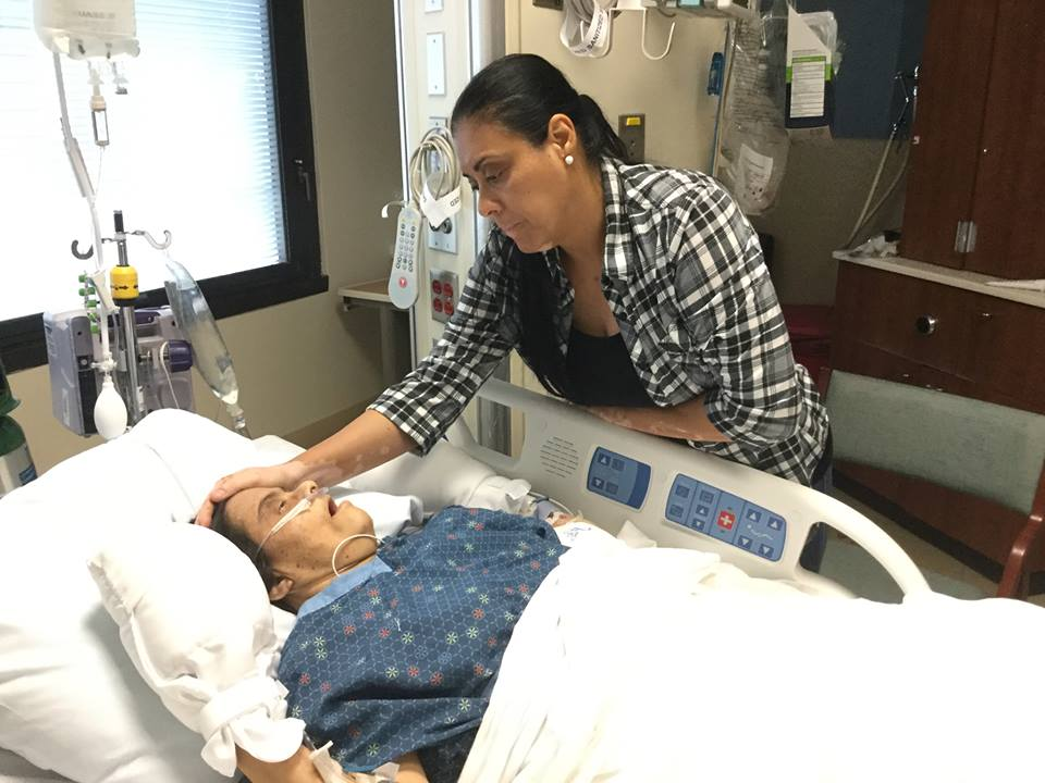 Orange County Soil & Water Conservation District Board Vice Chairman and Supervisor Daisy Morales cares for her special needs sister at Florida Hospital's intensive care unit who suffered severe neglect at a nursing home in Winter Garden. (Photo by Willie David / Florida National News).