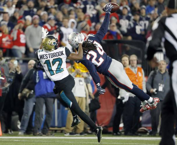 New England Patriots cornerback Stephon Gilmore (24) breaks up a pass intended for Jacksonville Jaguars wide receiver Dede Westbrook (12) during the second half of the AFC championship NFL football game, Sunday, Jan. 21, 2018, in Foxborough, Mass. (AP Photo/Winslow Townson)