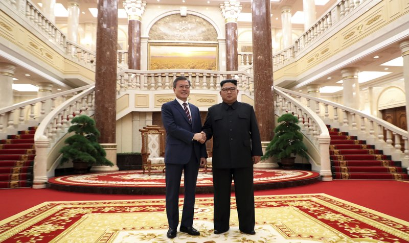 North Korean leader Kim Jong Un, right, shakes hands with South Korean President Moon Jae-in before their summit in Pyongyang, North Korea. (Pyongyang Press Corps Pool via AP)