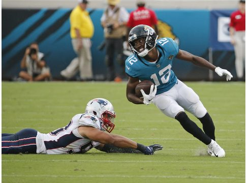 Jacksonville Jaguars wide receiver Dede Westbrook (12) runs for a touchdown past New England Patriots linebacker Kyle Van Noy, left, on a 61-yard pass play against the New England Patriots during the second half of an NFL football game, Sunday, Sept. 16, 2018, in Jacksonville, Fla. (AP Photo/Stephen B. Morton)