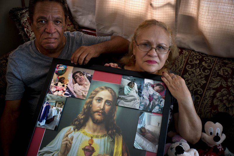 Maria Gonzalez Munoz (right) and her family mourn the death of her sister Ramona, who died from sepsis due to lack of medical treatment. Photo: AP.