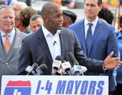 Tallahassee Mayor and Florida Democratic gubernatorial nominee speaks over DeSantis's protestors as he reiterates his goal to advance Florida's transportation system Thursday, October 4, 2018. Photo: Willie David/Florida National News.