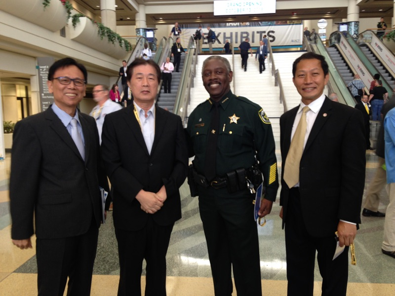 Andrew Jeng (right) with Orange County Mayor-elect Sheriff Jerry Demings (2nd right) and international associates at the 2018 International Association of Chiefs of Police (IACP) Conference at the Orange County Convention Center. Photo courtesy of the Andrew Jeng campaign.