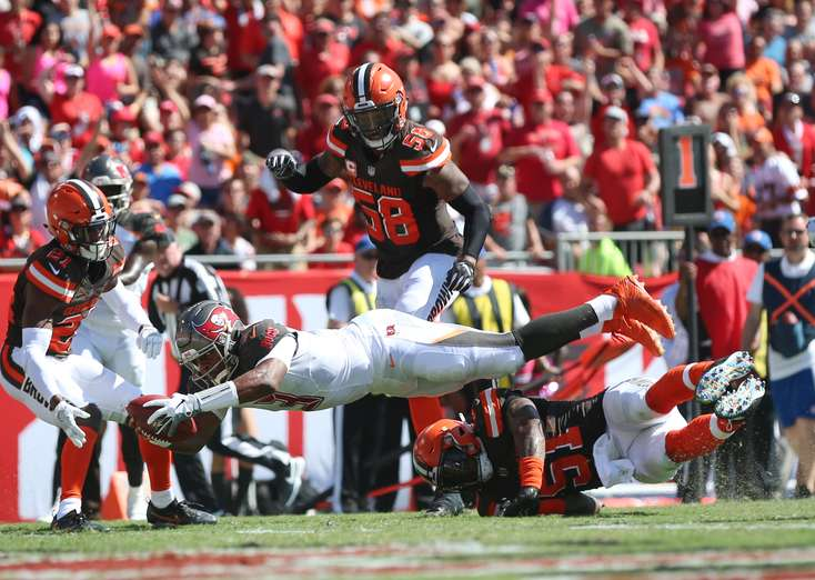 Bucs quarterback Jameis Winston (3) dives for a touchdown over Cleveland Browns outside linebacker Jamie Collins (51) in the second quarter. Photo: Monica Herndon/Tampa Bay Times.