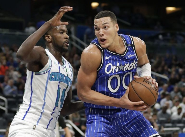 Charlotte Hornets forward Michael Kidd-Gilchrist (#14) blocks Orlando Magic forward Aaron Gordon (#00) at Amway Center Friday, October 19, 2018. Photo: AP.