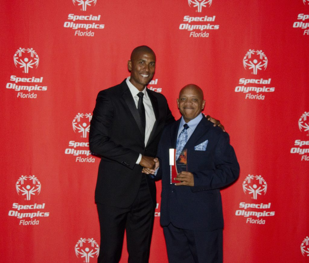 """Left to right: Former NBA star Raja Bell and Special Olympics FL """"Coach of the Year"""" Mike Cohen. Photo: Special Olympics Florida."""