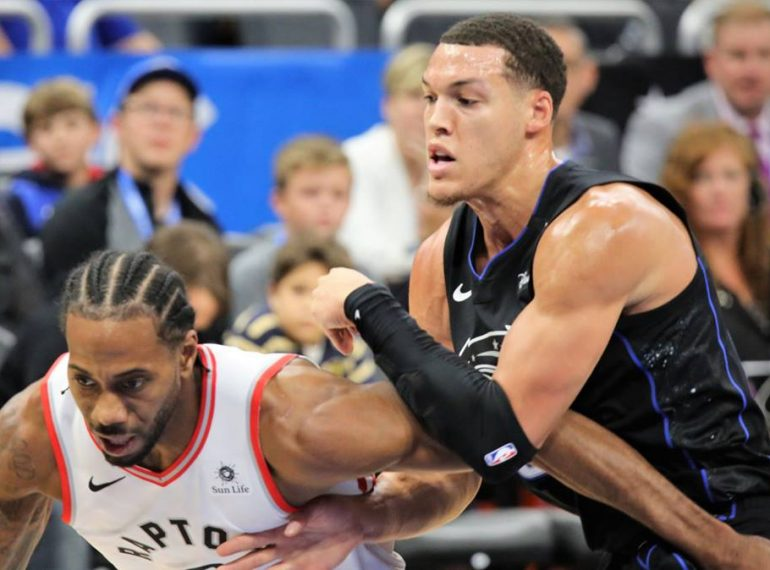 Orlando's Aaron Gordon (right, black uniform) attacks Toronto's Kawhi Leonard during the close matchup at Amweay Center Tuesday. Photo: Willie David/Florida National News.