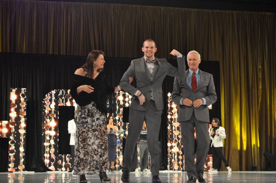 Philanthropist Harris Rosen (right) and his wife Trish (left) escort their son Adam down the runway during the 2018 Runway to Hope Spring Fashion Soiree at Rosen Shingle Creek earlier this year. Photo: Willie David/Florida National News.