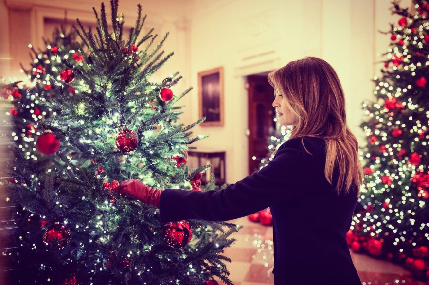 First Lady Melania Trump trims one of the many festive Christmas trees in the White House. Photo: @FLOTUS/Twitter