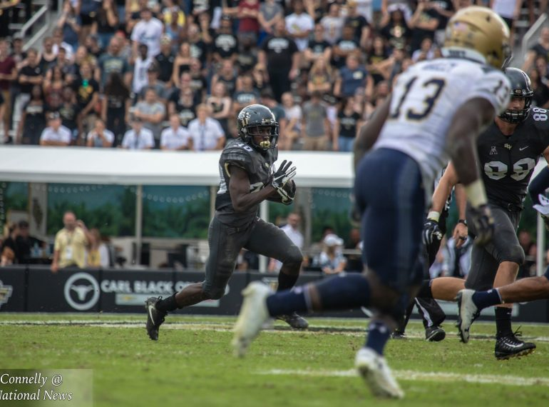 UCF running back Greg McCrae (#30) makes a run against the Navy Midshipmen at Spectrum Stadium Saturday. Photo: Brandon Connelly/Florida National News.