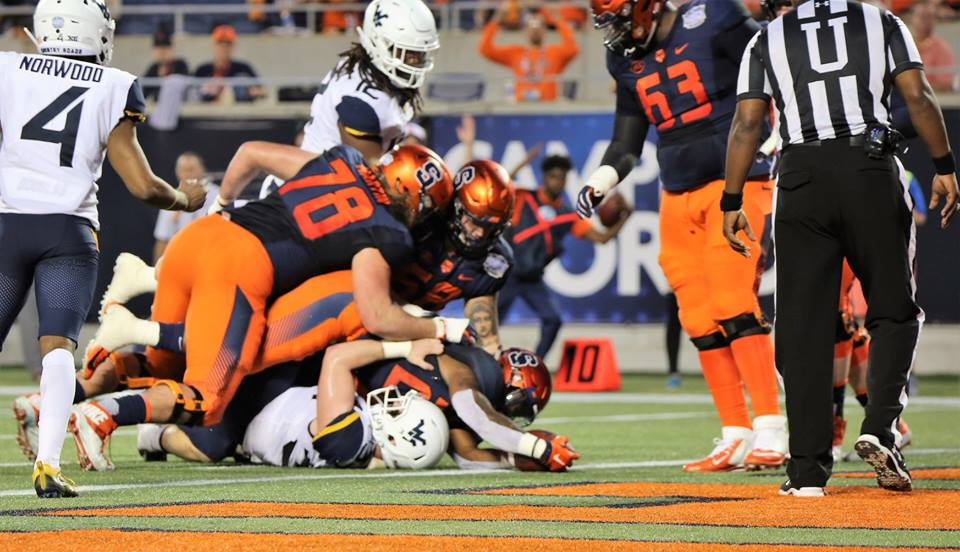The Syracuse Orange defense sacked West Virginia quarterback Jack Allison (#17, white uniform) five times during the 2018 Camping World Bowl at Camping World Stadium Friday, December 28, 2018. Photo: Willie David/Florida National News.